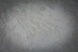 Grungy uneven gray background of natural cement textural.