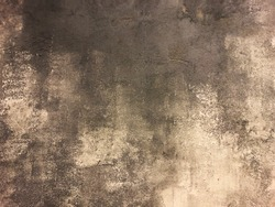 grungy unpainted concrete wall background in rough random pattern and seamless.