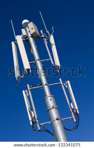 GSM Antenna against blue sky - stock photo
