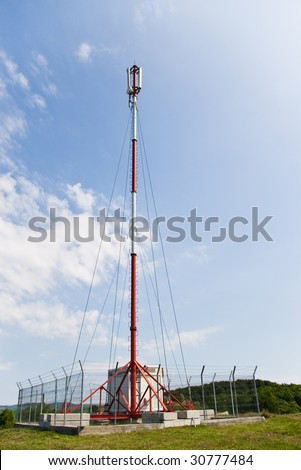 GSM transmission antenna on cloudy sky