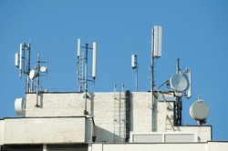 GSM transmitters on a roof of white administrative building. Close up