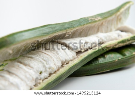 Guaba or cuaniquil: fresh South American fruit on white background Stock photo ©