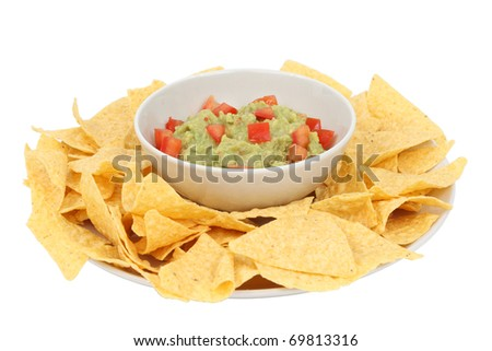 Guacamole and chips isolated over white background