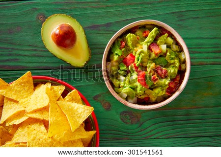 Guacamole with avocado tomatoes and nachos mexican food #301541561