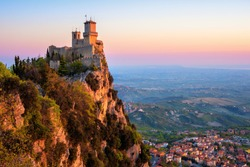 Guaita, the First of the Three Towers of San Marino, on the top of Mount Titano rock in sunrise light, Republic of San Marino. Guaita is UNESCO World Culture Heritage site.