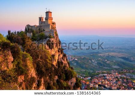 Guaita, the First of the Three Towers of San Marino, on the top of Mount Titano rock in sunrise light, Republic of San Marino. Guaita is UNESCO World Culture Heritage site.