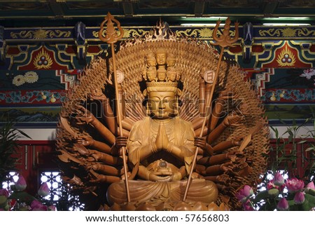 Guan Yin Thousand Hand carved of wood.