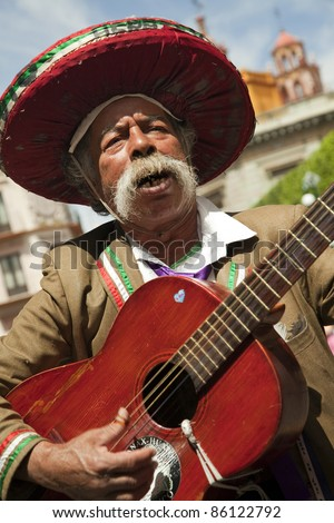 GUANAJUATO,MEXICO-MARCH 14:Unidentified Mexican guitarist plays on the streets of the Guanajuato city on March 14, 2010. Guanajuato is a picturesque and historic city, is located in central Mexico.