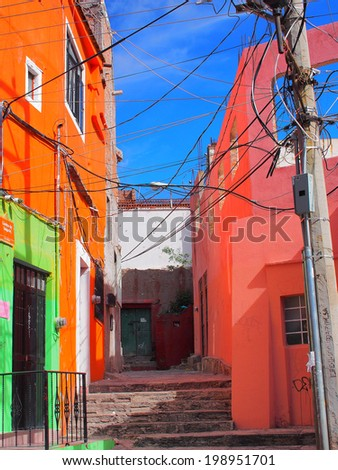 GUANAJUATO, MEXICO - OCTOBER 26, 2013: World Heritage Site (1988). Old building, painted with vibrant color in the Historic mine city of Guanajuato. The city has about 170,000 population.