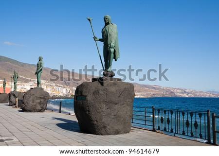 Guanche statues on waterfront. Plaza de La Patrona de Canarias, Candelaria, Tenerife, Canary Islands, Spain