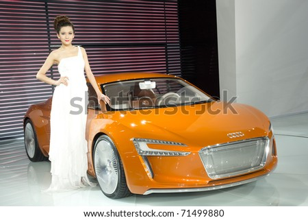 GUANGZHOU, CHINA - DEC 27: Fashion Model on Audi car at the 8th China international automobile exhibition on December 27, 2010 in Guangzhou China.