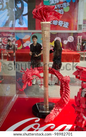 GUANGZHOU, CHINA - MAR 25: Design works on show at CocaCola Creative Design Exhibition, all works were design using wastes of Cocacola productions.  on March 25, 2012 in Guangzhou China.