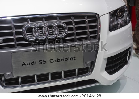 GUANGZHOU, CHINA - NOV 26: Audi S5 Cabriolet car on display at the 9th China international automobile exhibition on November 26, 2011 in Guangzhou China. - stock photo