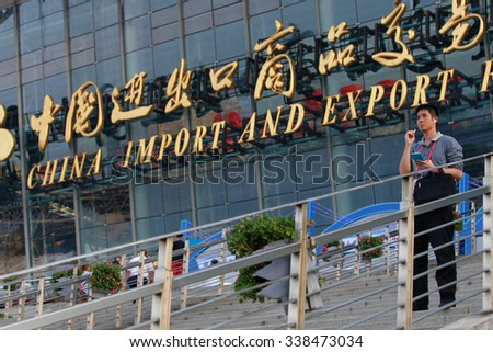 GUANGZHOU, CHINA - OCT 17. 2015:A man talks on his phone in front of China Import And Export Fair also known as Canton Fair. The Canton Fair is the largest trade fair in China.