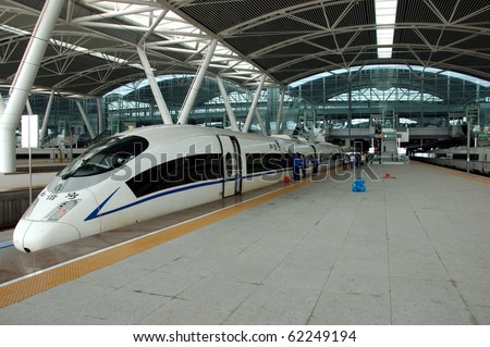 GUANGZHOU, CHINA - SEPTEMBER 29:Train to Wuhan on September 29, 2010 waits in newly build Guangzhou South station. China invests in fast and modern railway, trains with speed over 340 km/h.