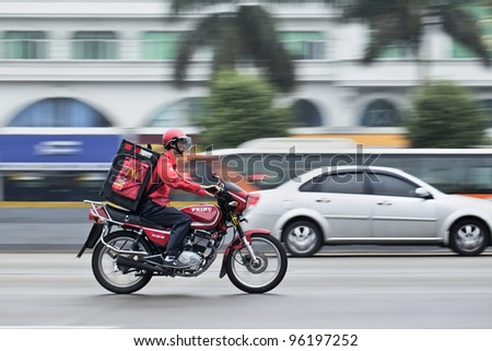 GUANGZHOU - FEB. 22: McDonald delivery motorcycle on Feb. 22, 2012 in Guangzhou. It took McDonald 19 years to reach 1,000 restaurants in China and the company plans to double the number to 2,000 by 2013.