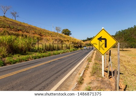 Guarani, Minas Gerais, Brazil - July 3, 2019 - Vertical signage on stretch of MG 353 highway, between municipalities of Piraúba and Guarani, Minas Gerais, Brazil