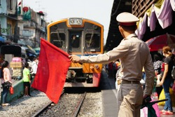 Guard With Red Flag On The Train Street, Reilway Station in Bangkok City, Thailand.