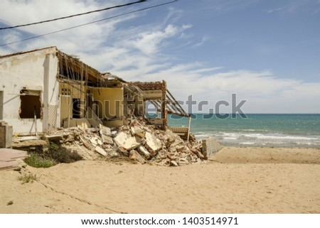 Guardamar, Alicante, Spain - May 20  2019 :  Damaged to buildings caused by storms of 2017 #1403514971