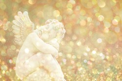 Guardian angel on shiny glow glitter background. Elegant abstract background with bokeh