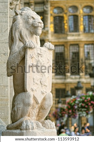 Guardian lion from medieval town hall on Grand Place in Brussels, Belgium at sunset