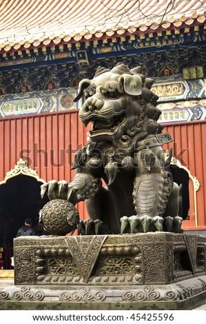stock-photo-guardian-lion-in-yong-he-gong-beijing-45425596.jpg