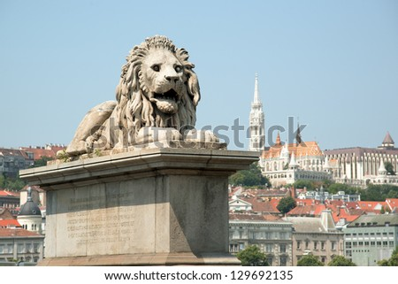 Guardian lion statue with Buda view, Budapest
