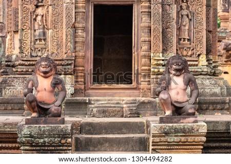 guardian sculptures in Banteay Srei temple, Siem Reap, Cambodia, Asia #1304494282