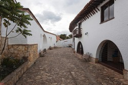 Guatavita colombian town alley autumn scene with colonial architecture and white cloudy day