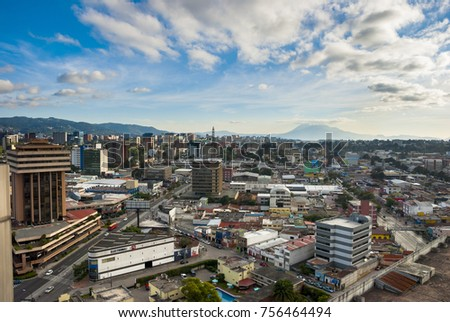 GUATEMALA CITY - January 04, 2017. Panoramic view of Guatemala City, modern and conservative architectural contrast, Central America, in the horizon volcan called Pacaya. EDITORIAL.
