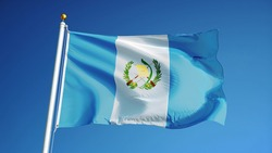 Guatemala flag waving against clean blue sky, close up, isolated with clipping path mask alpha channel transparency