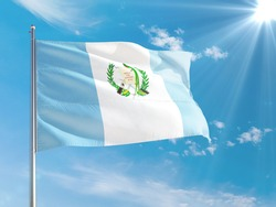 Guatemala national flag waving in the wind against deep blue sky. High quality fabric. International relations concept.