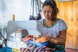 Guatemalan woman working with textiles in in San Juan La Laguna, Lake Atitlan, Guatemala