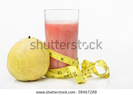 Guava and a glass of juice with measuring tape for diet and healthy life concept with lots of copy space