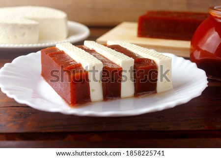 Photo of  Guava candy with cheese from minas. Goiabada with cheese, Brazilian dessert known as romeo and juliet. Selective focus