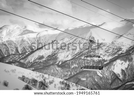 Gudauri six seat blue chair lift with caucasus mountains background. Blank space ski resort closure concept Zdjęcia stock ©