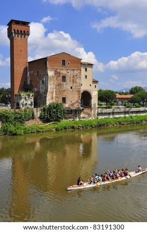 Guelph Tower of the old Citadel , Pisa , Italy, with a rower boat passing by