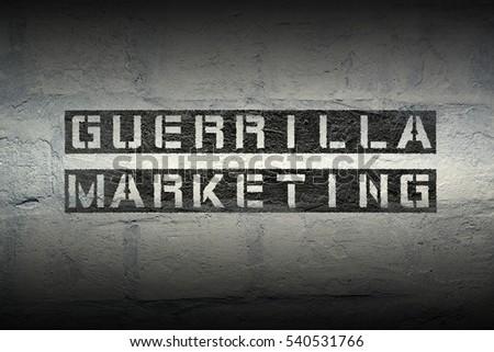 Shutterstock guerrilla marketing stencil print on the grunge white brick wall