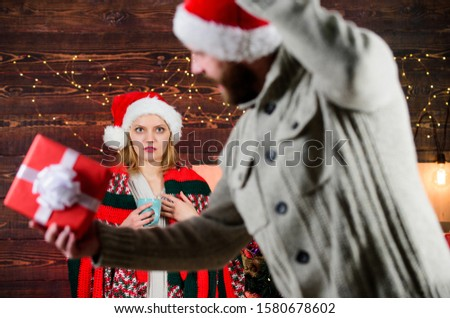 Guess her desire. Winter surprise. Man giving gift box. Christmas surprise concept. Giving and sharing. Generosity and kindness. Surprising his wife. Prepare surprise for darling. New year tradition.