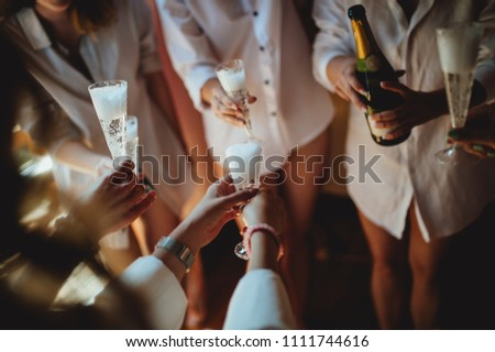 guest at the wedding with the bride clink glasses of  champagne or white wine on the balcony, morning, brides morning, hotel in the mountains #1111744616