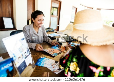 Guest booking a tour at a hotel