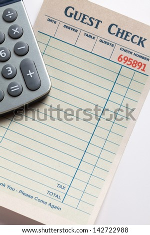 Guest Check and calculator, concept of restaurant expense. Fake Guest Check,