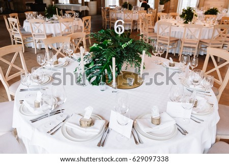 Guest table, with bouquet from petals and a number