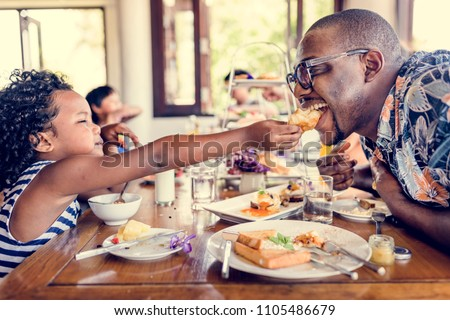 Guests having breakfast at hotel restaurant