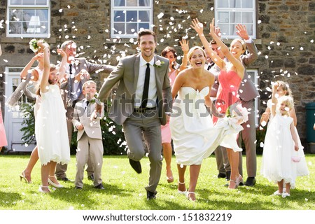 Guests Throwing Confetti Over Bride And Groom #151832219