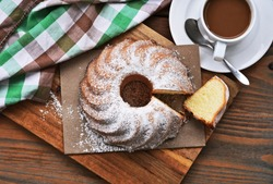 Gugelhupf or Kugelhupf on wooden background. It is popular cake in Central Europe.