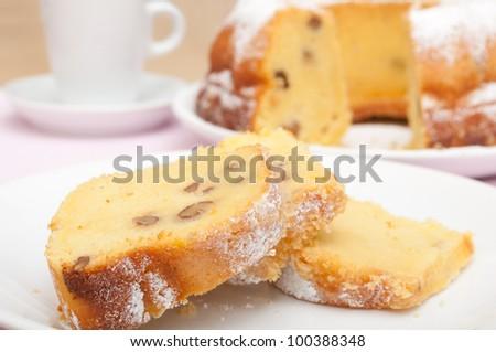 Gugelhupf - Slices of Traditional Gugelhupf Sponge Cake with Raisins and Walnuts