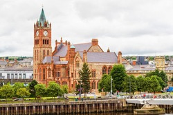 Guildhall in Derry by the Foyle river. Londonderry, Northern Ireland, United Kingdom.
