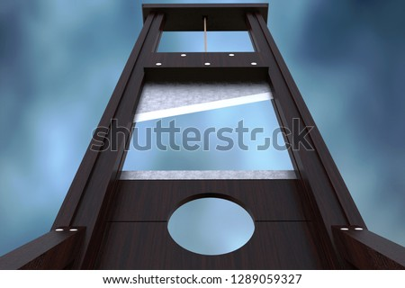 Guillotine instrument for inflicting capital punishment by decapitation and dramatic cloud background. Old wooden instrument for execution.  #1289059327