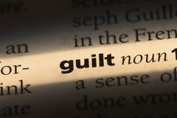 guilt word in a dictionary. guilt concept
